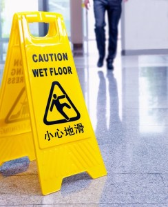 A yellow A frame sign indicating a safety hazard of a wet floor.