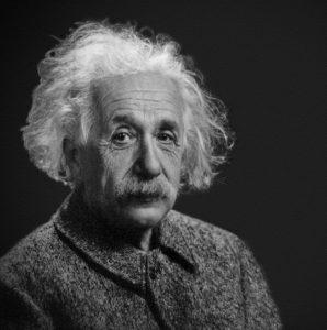 A black and white portrait of Albert Einstein.