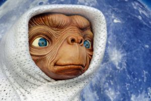 Sound Advice: ET, the ExtraTerrestrial wrapped in a white blanket standing against a backdrop of a starry night sky.