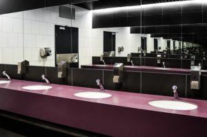 A row of handbasins in a public toilet.