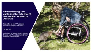 Header slide on accessible tourism showing a woman in a wheelchair bending down to feed a wallaby.