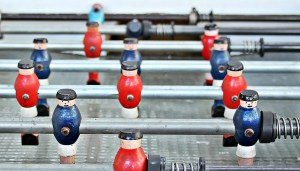 Foosball or Football Table with red and white teams. Games such as these are cater for workplace neurodiversity.