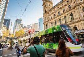 A Melbourne street scene showing pedestrians and a tram.