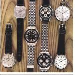 Seven watches on a wooden background
