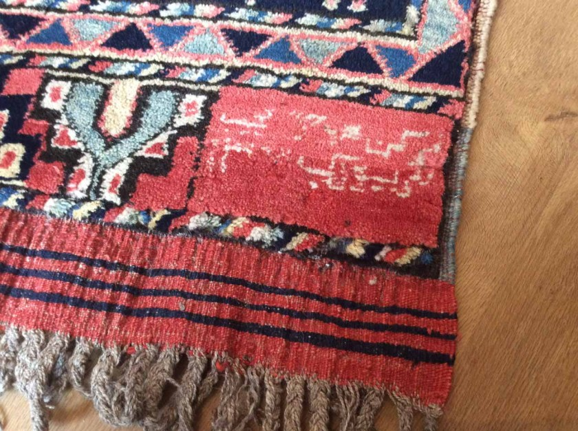 signature in a rug