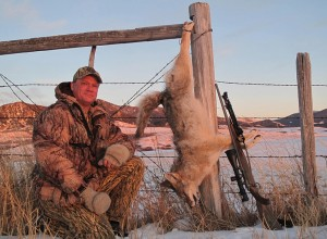 Troy Adams with one of his many coyote catches right as the sun sets in Montana.