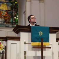 Rev. Kevin Boyd reads from Romans 12