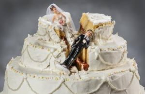 The bride was left heartbroken after her angry groom smashed the whole top tier of her wedding cake in her beautiful face.