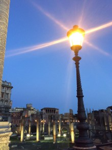 View of streetlamp and the columns of the Roman Forum at night