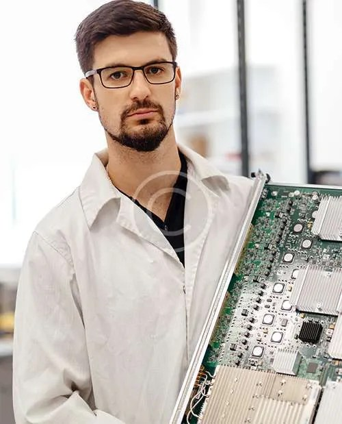technician-holding-large-circuit-board