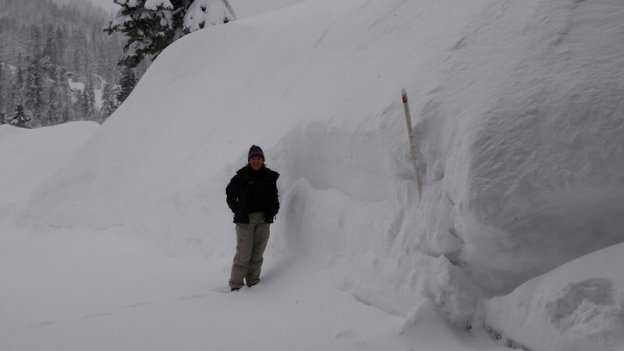 Andy captures a friends photo showing the snow banks in his driveway.