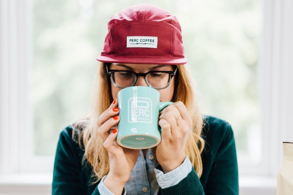 Melissa Drinking Coffee w: Hat