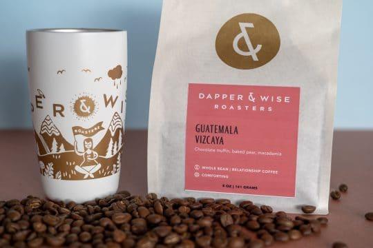 Dapper & Wise coffee tumbler and Guatemala coffee packaging