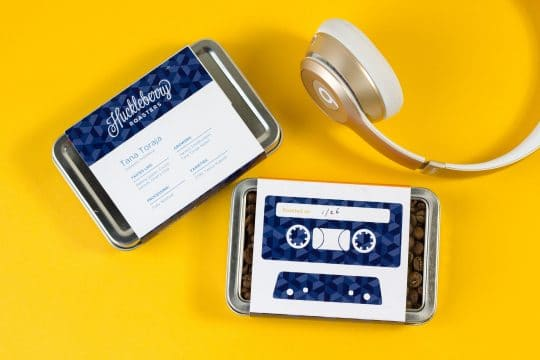 Huckleberry Coffee Cassettes on Yellow Background