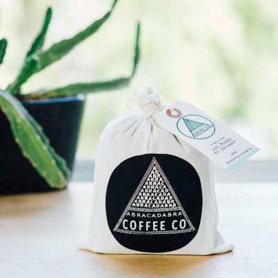 Abracadabra Las Nubes coffee in a branded coffee sack