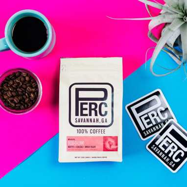 Perc Coffee Roasters Brazil Bob-o-Link coffee with coffee beans and stickers