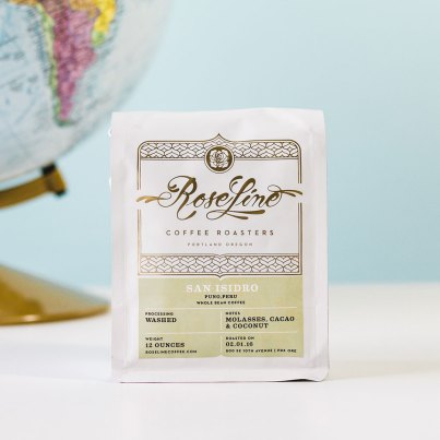 Roseline Coffee packaging with Globe in the background
