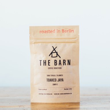 The Barn coffee bag on wooden table