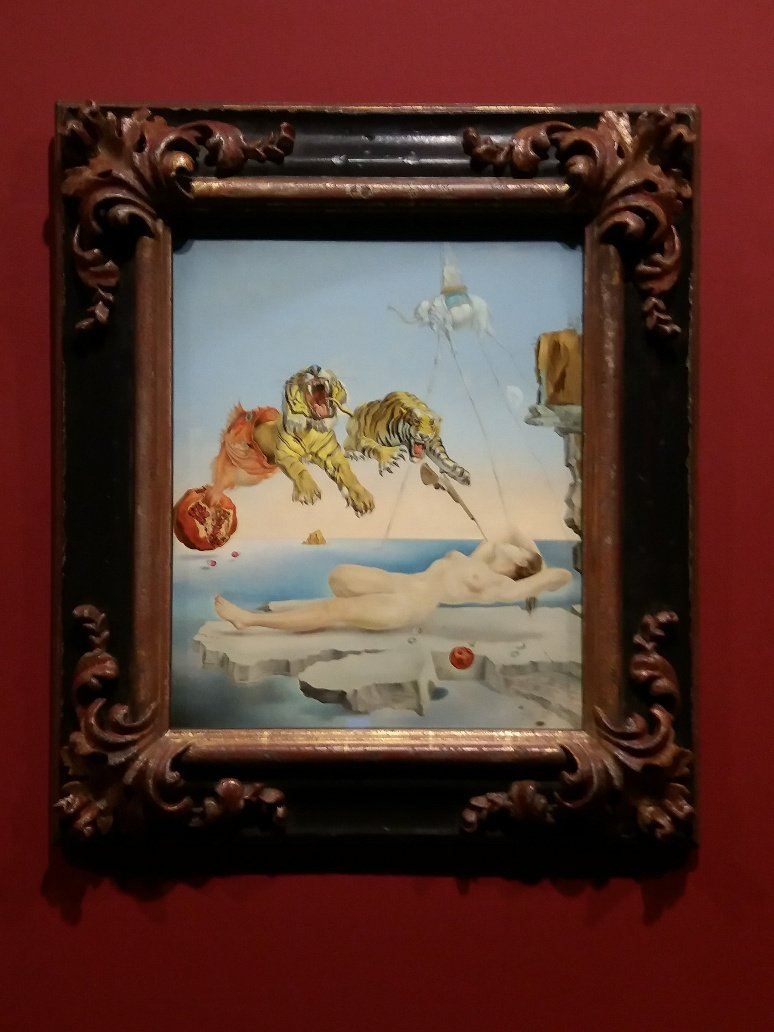 Dalí's Dream Caused by the Flight of a Bee around a Pomegranate a Second before Waking Surrealsim
