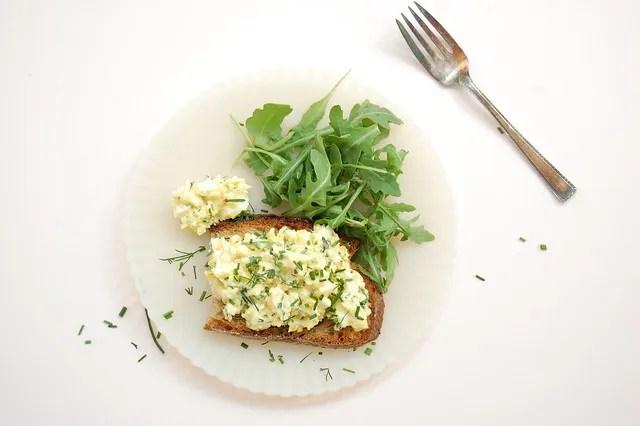 egg salad with fresh herbs on toast