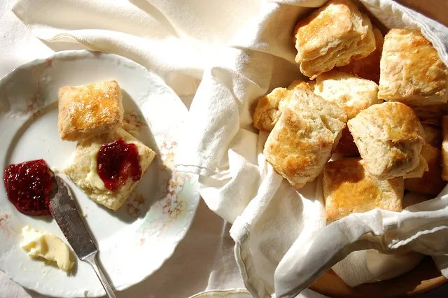 buttermilk biscuits in basket with raspberry jam
