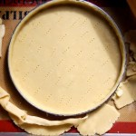 raw tart dough on Silpat with rolling pin