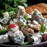 chicken salad with greens and toast on plate