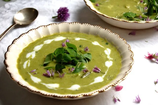 pea soup with sour cream garnish in bowl