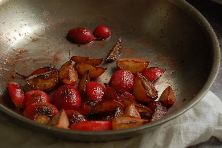 cooked butter roasted radishes in skillet