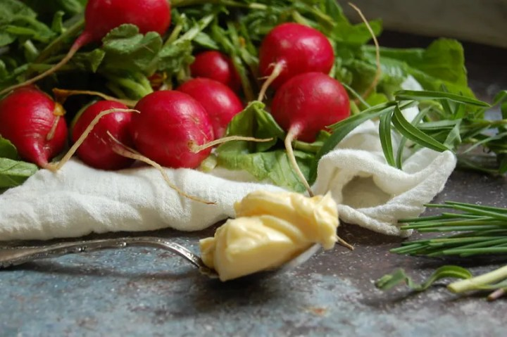 radishes and greens in bunch with butter and towel