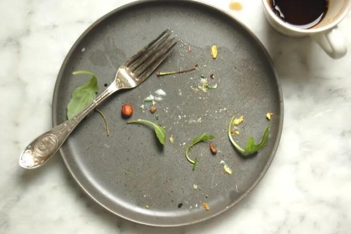 empty gray dish breakfast remnants