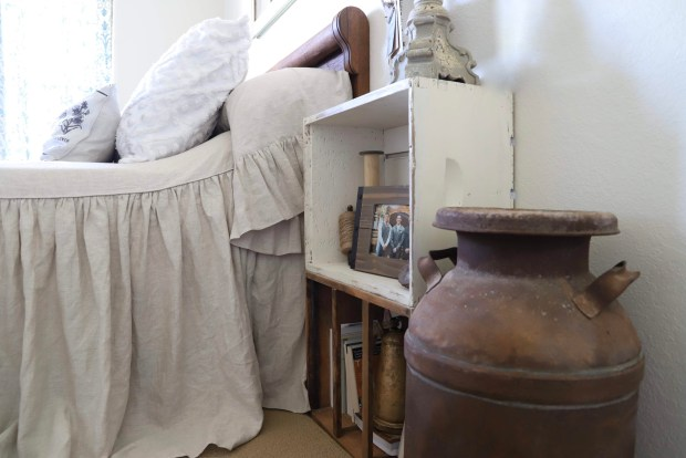 shabby Chic, farmhouse bedroom ideas include: old books, cotton wreaths, wild flowers in milk jars, vintage finds and an old milk jug