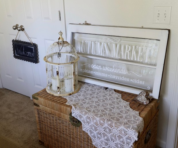 shabby chic bedroom ideas. I love decorating with vintage treasures including this wicker vintage trunk , old bird cage, and custom autumn window