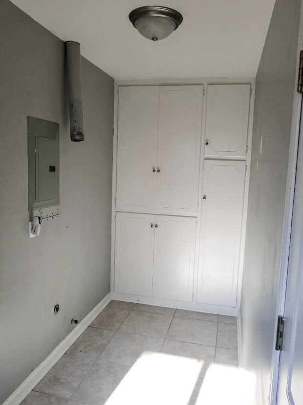 Before image of laundry/pantry room home renovation