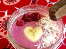 Rasberry banana coconut smoothie with chocolate garnish