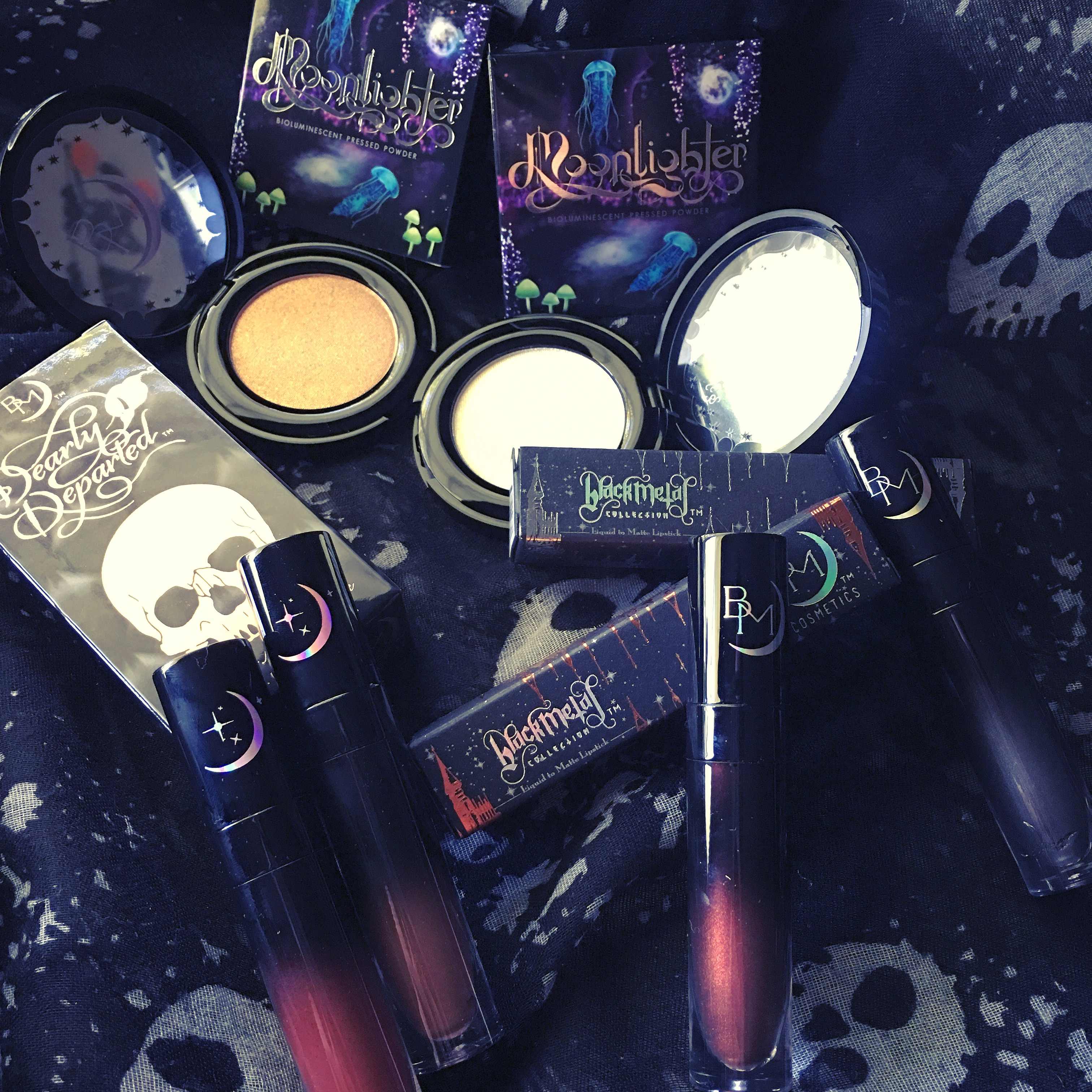 6 Black Moon Cosmetics highlighters and lipsticks