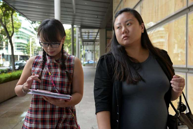Sisters Isabella Ng (left), 25, and Michelle Ng, 26, exiting the High Court after a pre-trial conference on May 17, 2016. ST PHOTO: MARK CHEONG (via straitstimes.com)