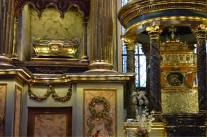 The 3 patron saints of the city are entombed in one of its churches, skulls on display and everything
