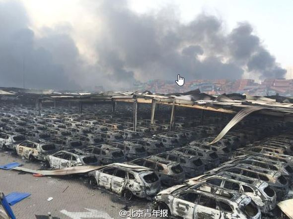 Cars burnt out near the site of huge explosions in China Tianjin