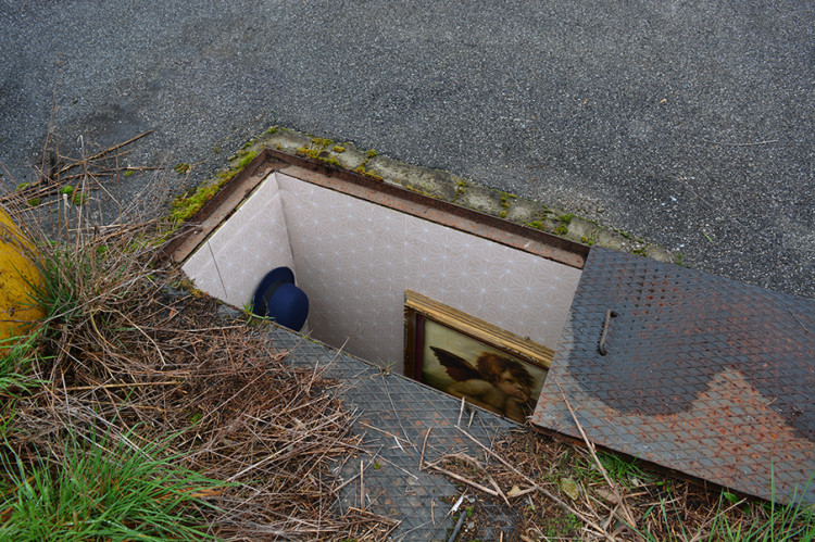 Italian Artist Creates Tiny Rooms Inside Manholes