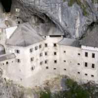 A 13th Century Slovenian Castle That Sits on a Cliffside Is Anchored Into Place by Ancient Caves