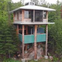 Stunning 2 Story Treehouse Made From 20 Years of Collecting Scrap Materials