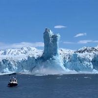Colossal Ice Pillar Rises 200 ft Above Water in Alaska