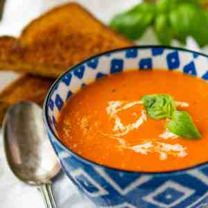Homemade Tomato Soup -- this creamy tomato basil soup recipe is a total copycat of my favorite soup at First Watch! Perfect paired with a hot and fresh classic grilled cheese sandwich…   via @unsophisticook on unsophisticook.com
