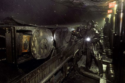 Miners work at an underground coal mine in Changzhi, Shanxi province.