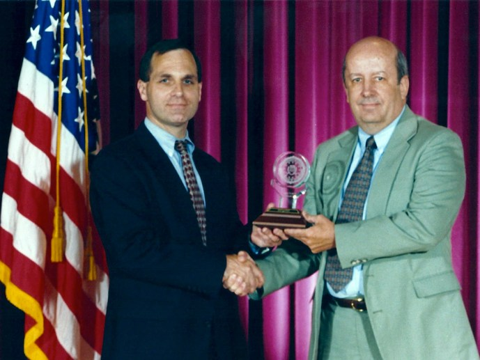Kenneth Lanning receiving Director's Annual Award for Special Achievement for Career Accomplishments in connection with Missing and Exploited Children, 1997