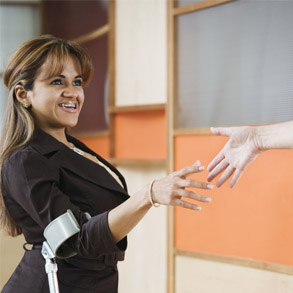 Handicapped young woman shaking hands.