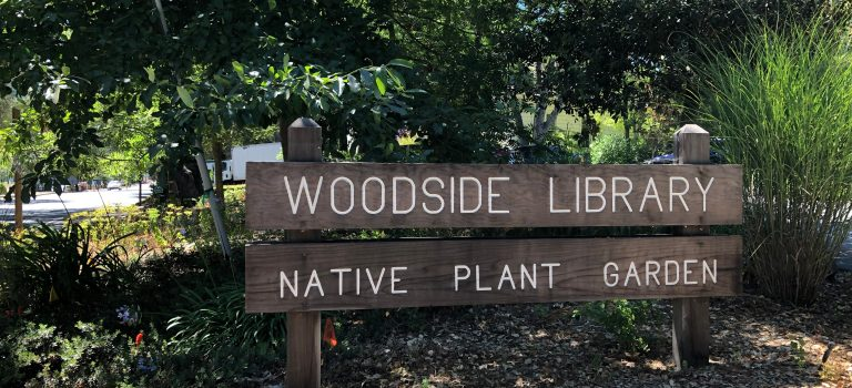 Sign for the Woodside library and the native plant garden.