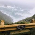 At the Devils Slide Coastal Trail a warning sign: Step back steep cliff.