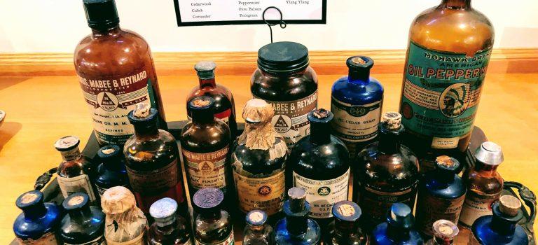 Antique bottles filled with essential oils, at the Aftel Archive of Curious Scents.